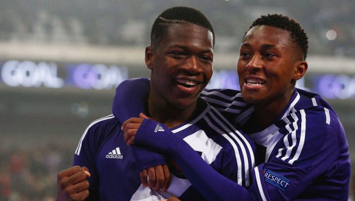 BRUSSELS, BELGIUM - MARCH 18:  Aaron Leya Iseka (L) of Anderlecht celebrates scoring a goal from the penalty spot completing his hat trick with team mate Samuel Bastien during the UEFA Youth League quarter final match between RSC Anderlecht and FC Porto at Constant Vanden Stock Stadium on March 18, 2015 in Brussels, Belgium.  (Photo by Dean Mouhtaropoulos/Getty Images for UEFA)